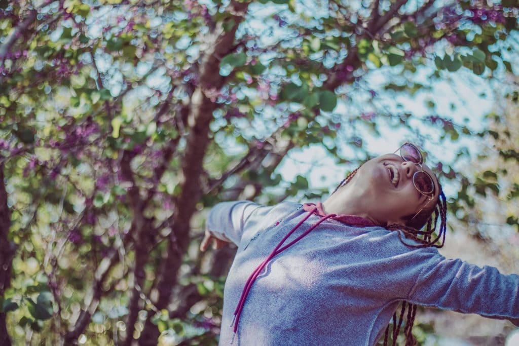 happy woman in woods